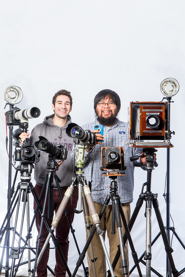 University Relations photographers Zayn Roohi and JR Ancheta pose for a portrait with all of their cameras on Sep. 27 in Eielson 303.
