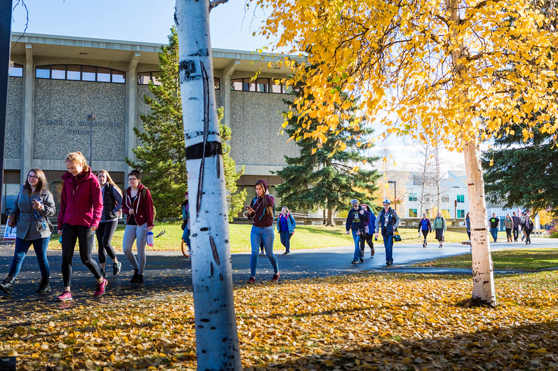 Students walk to and from class on a late September afternoon.