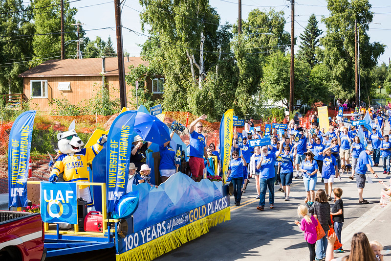 Members of Nanook Nation wear their blues and golds during the 2017 Golden Days Grande Parade in downtown Fairbanks on July 22. Judges awarded UAF's float, which celebrated the university's centennial, as the best noncommercial entry.