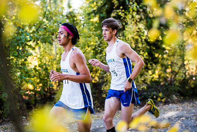 Cross country runner Seiji Takagi (left) is followed by Jacob Walsh (right) during the Moda Health Blue and gold meet on Sept. 8.