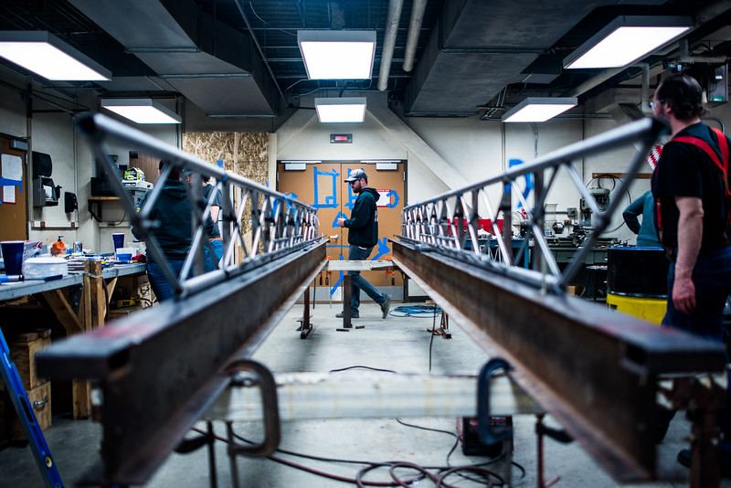 Civil Engineering student Danny Smith walks across the room while working on UAF's entry to the Steel Bridge contest. With less than two weeks to go, the students involved were in the lab for more than 12 hours on both Saturday and Sunday.