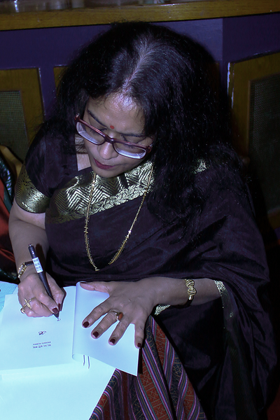 Signing the book