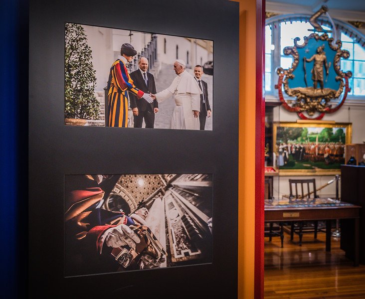 Recent photographs include those with Pope Francis.