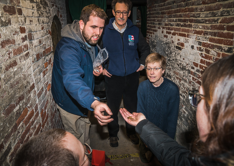 Boston Archeologist Joe Bagley (standing left) oversees the crypt dig with Old North Church Vicar and Foundation President Steve Ayres  (standing right) and community volunteers.