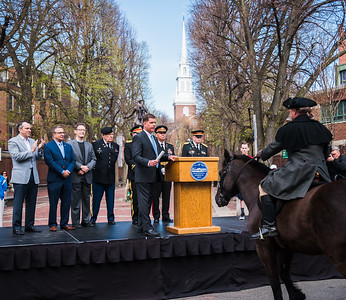 Paul Revere rides on Brown Beauty to pick up his orders from Boston Mayor Marty Walsh