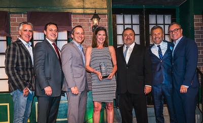 Debbie DiMasi accepts the TONE award on behalf of her husband, Sal DiMasi