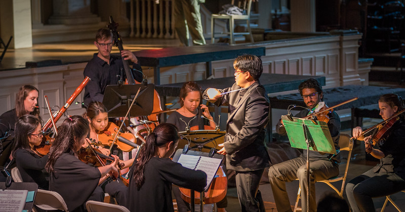 Dr. Tiffany Chang conducts the orchestra