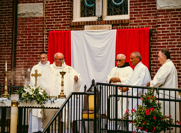 Father Antonio and clergy of St. Leonard Parish at outdoor Mass