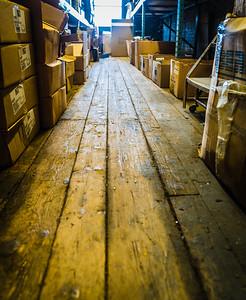 Wood floor along the supply aisles