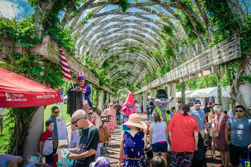 Harborfest crowd under the trellis
