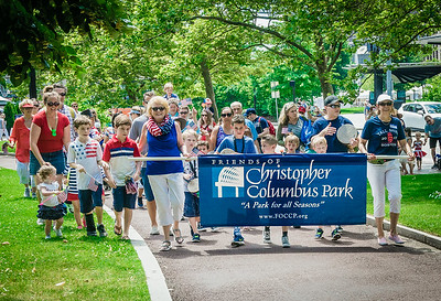 Friends of Christopher Columbus Park march in the Indendence Day celebration