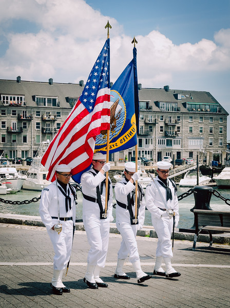 US Navy color guard marches at Christopher Columbus Park on the North End waterfront