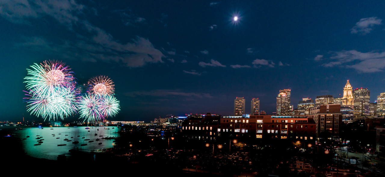 Duel firework volleys illuminate Boston Harbor to celebrate the end of summer