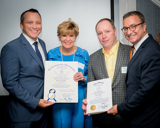 State Rep. Aaron Michlewitz (left) and City Councilor Sal LaMattina (right) present citations for the Prince Building to residents Anne Devlin Tagliaferro and John McDonnell