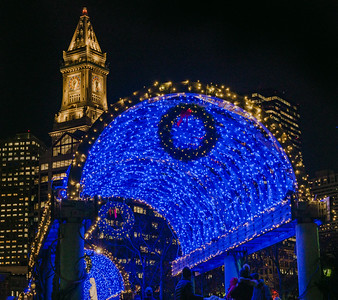 Blue lights on the Columbus Park trellis with Custom House tower