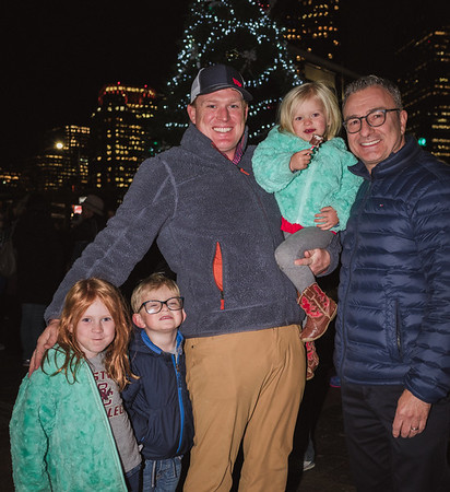 Family poses with Councilor LaMattina at the Tree Lighting