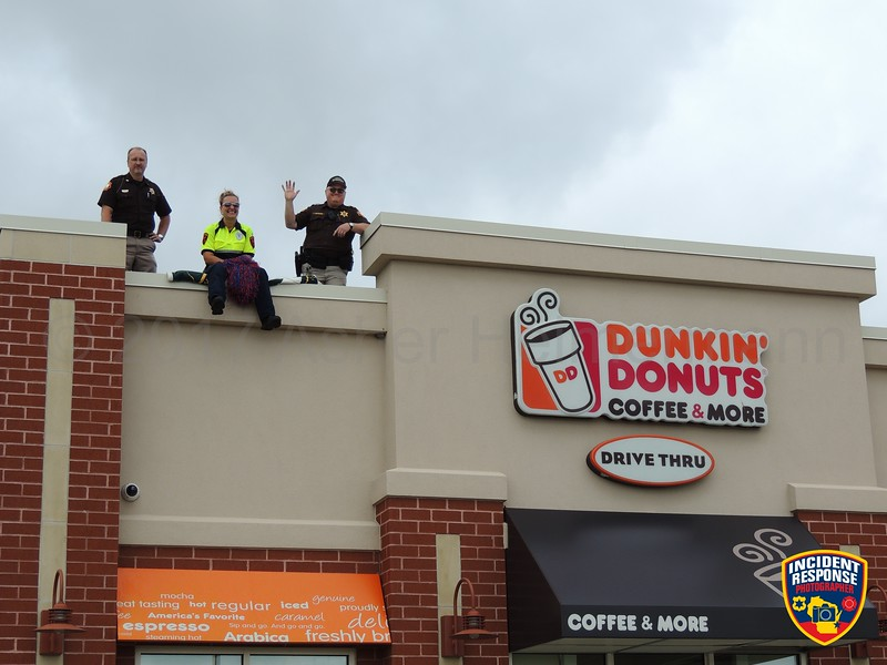 Sheboygan County law enforcement officers participate in Cop on a Rooftop benefiting Special Olympics Wisconsin at Dunkin' Donuts in Sheboygan, Wisconsin on Friday, August 11, 2018. Photo by Asher Heimermann/Incident Response.