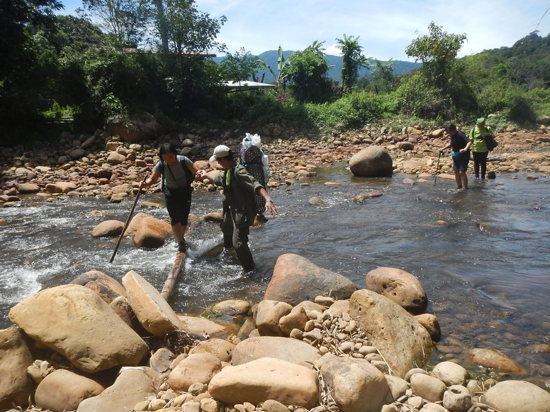 Welson gives a helping hand at Trusan River crossing.