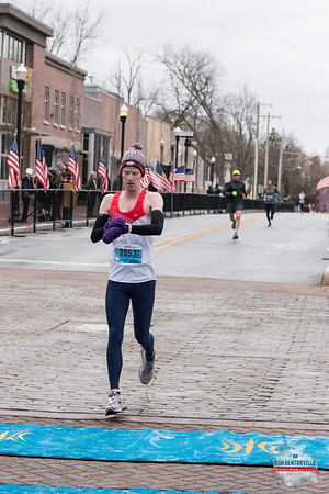 Braving the frigid temps and snow, runner pushed through the 13.1 miles of the Bentonville Half Marathon to the finish line at the Bentonville Square.