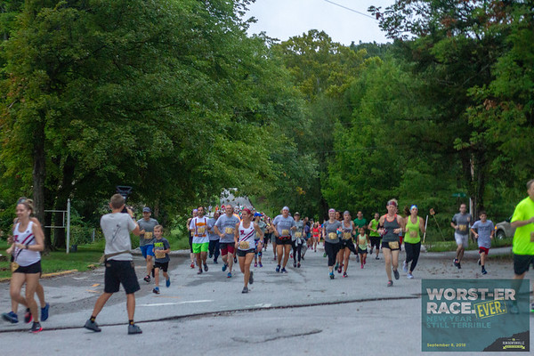 A gloomy Saturday morning runners gathered for the Worst-er Race Ever put on sarcastically by the Bentonville Parks and Rec as part of the Run Bentonville Race Series and joined by various blips throughout the course and even a cameo by Chewy and the Chic-Fil-A cow.