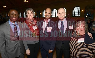 From left, Doug Thompson, Kris Donnelly, 2018 40 Under 40 winner Alvin Abraham of the University of St. Thomas, Nick Nagurski and Corri Carvalho