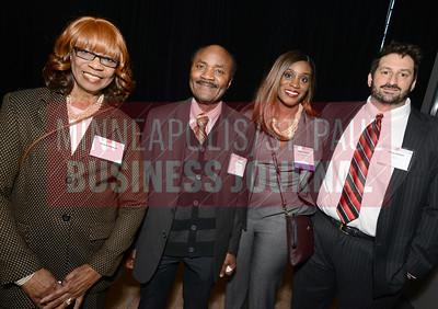From left, Mable Momoh, Kofi Momoh, 2018 40 Under 40 winner Adine Momoh of Stinson Leonard Street LLP and Vince Baillet
