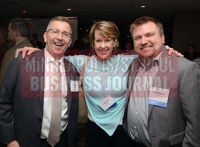 From left, Flip Seifert of the St. Paul Area Chamber of Commerce, Kathy Heil of Story Teller and Todd Vaske of Story Teller