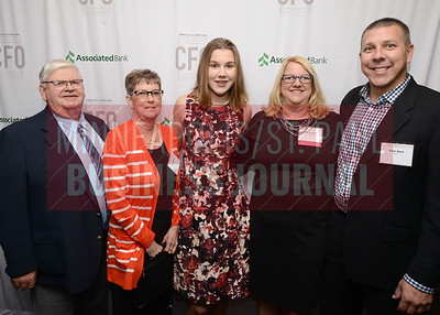 From left, Steve Geers, Lila Geers, Sophie Hart, CFO of the Year honoree Jolene Hart of Junior Achievement and Tom Hart