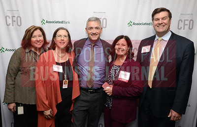 From left, Margie Kissner, Wendy Mortimer, Norm Kruse, CFO of the Year honoree Stacy Kruse of Portico Benefit Services and Jeff Thiemann