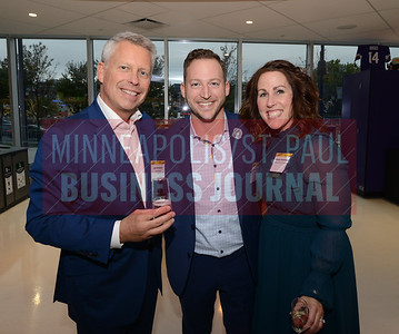 From left, Jim Erickson, Andrew PAyne and Minneapolis/ St. Paul Business Journal publisher Kathy Robideau