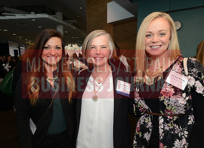 From left, Danielle Pfeifer of SPIRE Credit Union, Science Museum of Minnesota president Alison Brown and Rachael Reiling of SPIRE Credit Union.