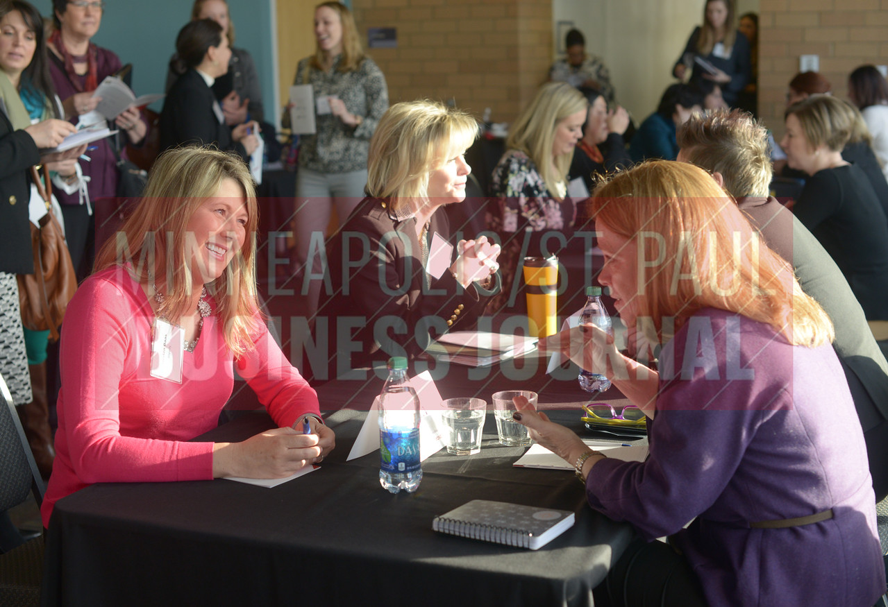 Kristen Baas of Insperity talks with PNC Bank regional president Kate Kelly at Mentoring Monday at the Minnesota Science Museum.
