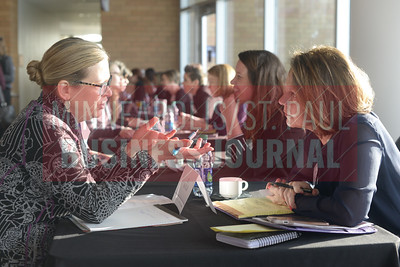 Heidi Schuster of Aldis Systems speaks with mentor B Kyle of the St. Paul Arae Chamber of Commerce at the Minneapolis/St. Paul Business Journal's Mentoring Monday event.