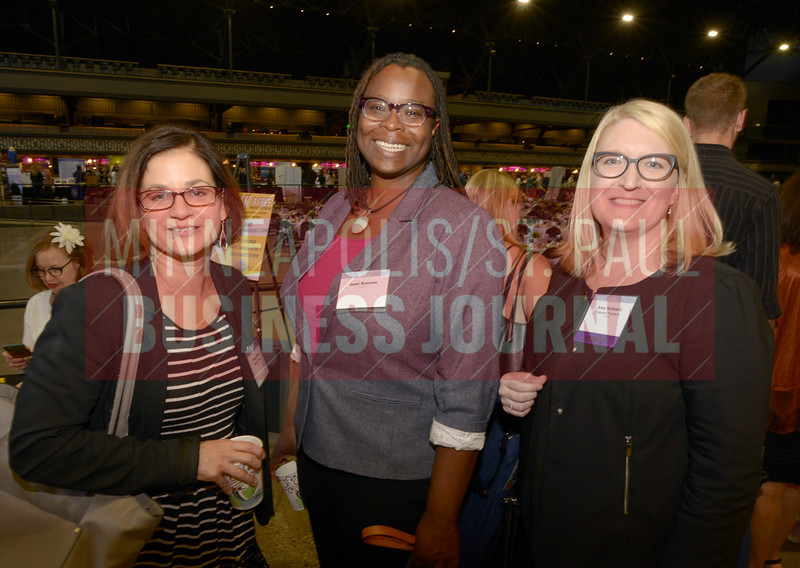 2018 Women in Business honoree Amy Salmela of Patterson Thuente IP (right) along with Tracy Dann and Jumi Kassim (center).