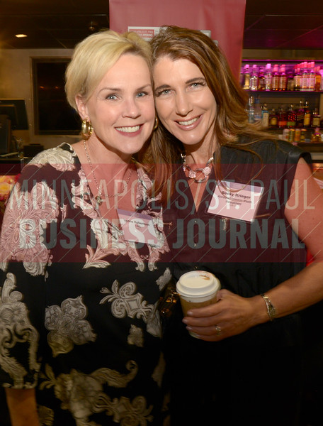 Lynn Robertson of FAME and Becky Krieger of Accredited Investors Wealth Management stopped for a picture at th 2018 Women in Business event.