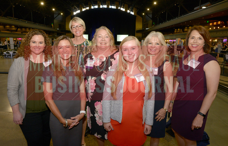 2018 Women in Business honoree J. Marie Fieger of Nemer Fieger (center) stopped for a photo with employees from Nemer Fieger.