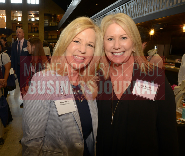 Lynn Roth (left) of Bridgewater Bank and Bed Busch of USI Insurance Services