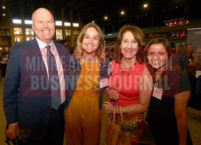 2018 Women in Business honoree Kelly Elkin of Old National Bank with husband Phillip, daughter Claire (left) and Haley Tansom (right)