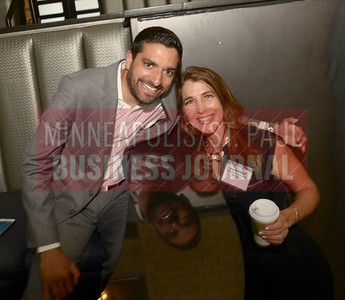 2018 40 Under 40 honoree Adam Rao of Sunrise Bank (left) and Becky Krieger of Accredited Investors Wealth Management