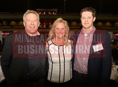 2018 Women in Business honoree Lori Bauer with her husband Mike and son Jake.