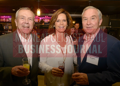 2018 Women in Business honoree Lori Larson of Dougherty Real Estate Equity Advisors along with Tom Holtz (left) and Jim Heller