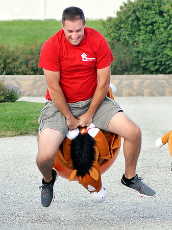 John P. Cleary | The Herald Bulletin<br /> The eighth annual Guns & Hoses charity event at Hoosier Park. Alexandria Fire Chief Brian Cuneo takes a big hop during the Bounce Horse Race. Cuneo, the twice defending champion of this race came in second this year.