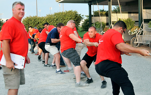 John P. Cleary   The Herald Bulletin<br /> The eighth annual Guns & Hoses charity event at Hoosier Park. The firefighters tug of war team pulls to a victory over the police.