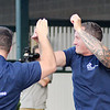 John P. Cleary | The Herald Bulletin<br /> The eighth annual Guns & Hoses charity event at Hoosier Park. Matt Guthrie, of APD, gets congratulation from a fellow officer after winning the Bounce Horse Race.