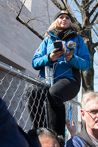 WLNY-New York (CBS Channel 2) reporter atop the fence near the East Wing of the National Gallery -- March for Our Lives, March 24, 2018 for ending gun violence in schools after the Parkland, FL school massacre.