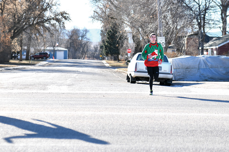 Matthew Gaston | The Sheridan Press<br>16-year-old Jason Barron was the first to finish the Tongue River Valley Community Center's Ugly Sweater Run in Ranchester with a time of 20 mintues and 45 seconds Saturday, Dec. 15, 2018.