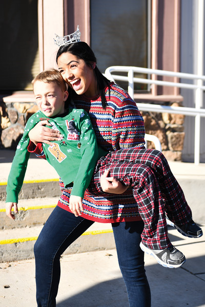Matthew Gaston | The Sheridan Press<br>Miss Wyoming 2018 Beck Bridger clowns around with 7-year-old Camdin Miles after the Tongue River Community Center's Ugly Sweater Run Saturday, Dec. 15, 2018.
