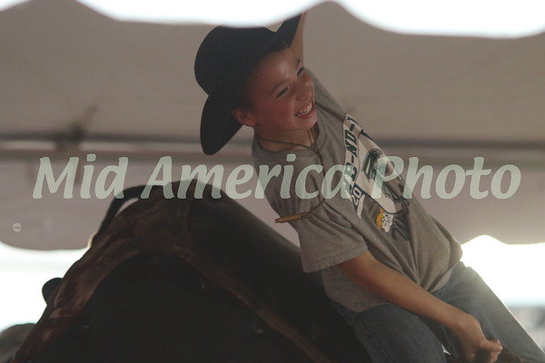 Boy riding mechanical bull
