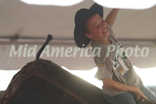 Boy riding mechanical bull