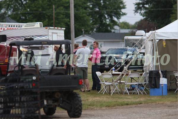 Bull  rider Jay Morrow (pink shirt) taking with family